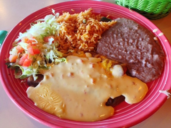 The Cheesy Enchilada: a cheese enchilada plate topped with guisada gravy and queso. Please bring this back Las Palapas, please bring it back!